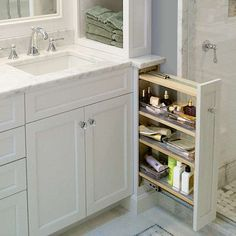 "TOH fan Tom Fiore of New Jersey on his favorite space-saving built-in: ""After designing a custom double vanity for our master bath, we were left with almost 6 inches of space on each side. My wife had the idea for spice-rack-style storage, so I built these pullouts."""