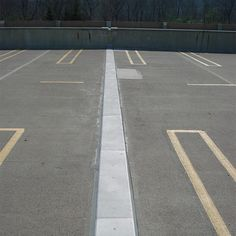 Hundreds of feet of deck expansion joint at the vast parking facility of this corporate center was replaced using the SJS Seismic Joint Systemfrom EMSEAL. Installed over a grey elastomeric nosing material supplied by EMSEAL, the system is quiet, watertight, and handles the thermal cycling induced by temperature…