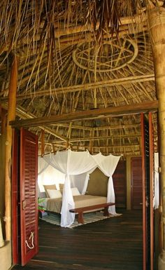 Casitas are furnished simply but feel exotic with canopy beds and handcrafted furniture. Reclaimed Wood Coffee Table, Destin Beach, Small Tables, House Design, Furniture, Building, Outdoor Decor, Canopy Beds, Latin America