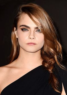 Great hair - Cara Delevingne went for a double cat-eye with a winged eyeliner and a smokey brown eyeshadow