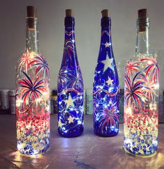Creative Wine Bottle Crafts With Lights You Want For Your Home Fireworks Wine BottlesFireworks Wine Bottles Empty Wine Bottles, Wine Bottle Corks, Painted Wine Bottles, Lighted Wine Bottles, Decorative Wine Bottles, Wine Bottle With Lights, Wine Bottle Lighting, Vodka Bottle, Wine Bottle Lanterns
