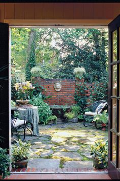 A small backyard garden doesn't have to limit your design desires. Check out these ways to make even the tiniest yard into an outdoor getaway anyone can enjoy. French Courtyard, Small Courtyard Gardens, Courtyard Design, Small Courtyards, Outdoor Gardens, Brick Courtyard, Courtyard Ideas, House With Courtyard, Small Backyard Landscaping