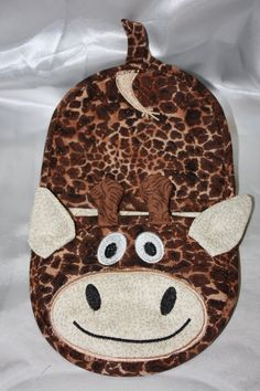 Giraffe oven mitt pot holder in the hoop by Christysdigitalfiles