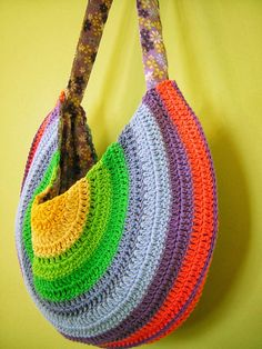 A lovely version of this: http://allcraftsblogs.com/crochet_purse_patterns/summer_sling_purse/crocheted_summer_sling_purse_pattern.html