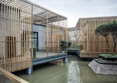 Floating tea house in Yangzhou, by Chinese architects HWCD Associates, features brick rooms linked by louvred bamboo corridors and brises soleil.