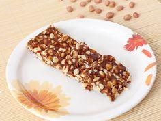 Peanut Chikki (Peanut Brittle) prepared with jaggery. Healthy alternative of sugar candy for kids.