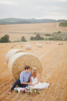 A bale of hay makes a perfect prop for an outdoor wedding photo on the farm