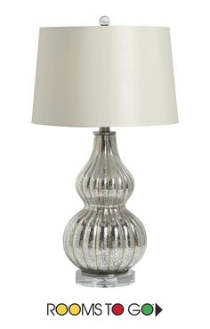 A testament to contemporary design, the Asterion table lamp features a gourd inspired shape with a crystal base.