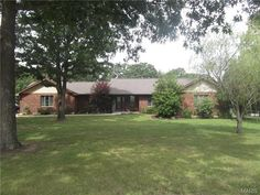 Beautiful landscaping surround this spacious brick home in Salem, MO.