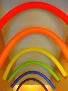 What a great idea for rainbow birthday party decorations, using pool noodles! | CatchMyParty.com
