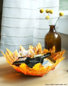 DIY centerpiece bowl with fall leaves, ModPodge over balloon to form bowl of fall leaves!