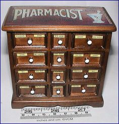 A charming 12 drawer cabinet for your miniature pharmacy or chemist project.