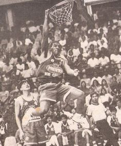 Tank Collins of the Presto Ice Cream Kings takes a left-handled slam dunk  over Vergel Meneses in action of the 1992 PBA First Conference at The  ULTRA b632e508c