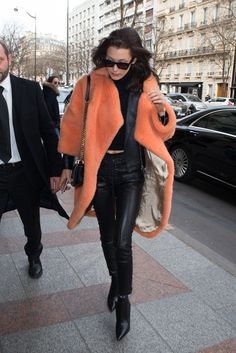 Bella Hadid wore layered jackets, leather leggings and black booties while out in Paris.