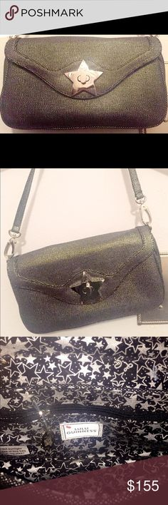 Lulu Guinness Handbag This is an adorable purse by Lulu Guinness London. It's silvery metallic grey, with a silver star detail on the front. The inside is black with printed stars. The shoulder strap is detachable, so the handbag doubles as a clutch. It has never been used and comes with the duster. lulu guinness london Bags Mini Bags