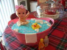 Baby doll bathtub cake:  Dollar Tree tub, cake cut and layered with buttercream around the baby doll.  Dollar General baby doll. Fondant soap and wash rag, buttercream bubbles