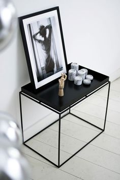 Black & white monochromatic minimal interior inspiration - HAY tray table, b&w photography, marble candle holders