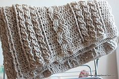 I found this free pattern in Ravelry, the Celtic Afghan pattern by Lion Brand Yarn.  I ordered 20 skeins of Bernat Chunky yarn and the biggest crochet hook I could find!  All this to satisfy my need for a big knitted cabled blanket.