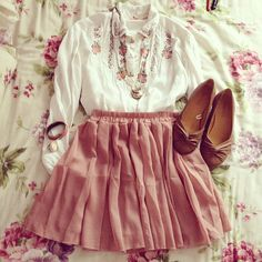 The accents on the blouse are perfect.