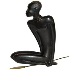This original 1930's patinated brass African Warrior Sculpture was produced in Austria by Hagenauer. One of the larger African bronze pieces by Hagenauer, known for their modernist designs, the gracefulness of this design makes a strong statement.