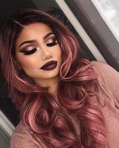 The woman has beautiful hair and makeup!!