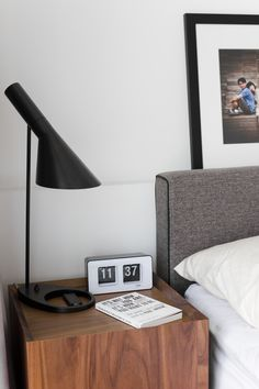 Bedside table storage from AIR Division and AJ Lamp.  Flip clock from Typo.