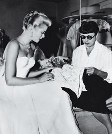 """Edith Head  The question isn't who did she design for, but what iconic movie star did she not design for.  A tiny, straight-banged woman dressed in unimposing neutral colors, Edith Head didn't appear to be a fashion powerhouse. """"Don't let her kid you,"""" her Hollywood competitor Walter Plunkett famously said. """"She owns a 50-acre estate surrounded by a picket fence of nothing but Oscars."""""""