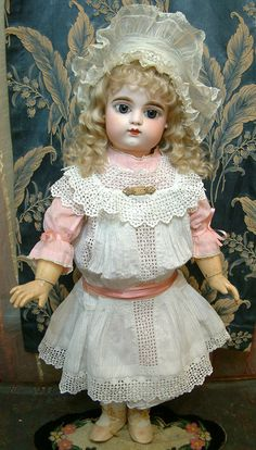 My mothers last creations were porcelain reproduction dolls. I have molds to make more of the same. (I'm particularly fond of the ones with lots of teeth. ;) ) (This is a Francois Gaultier Bebe. )
