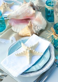 Beach wedding reception table decorations.