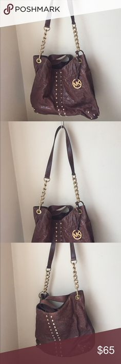 Michael Kors Dark Brown Studded Purse Dark brown shoulder purse with gold accents. Can wear it as a short shoulder bag and there is also a longer handle. Great shape. Michael Kors Bags Shoulder Bags