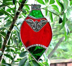 Stained glass victorian Christmas ornament. Red and green holiday sun catcher keepsake window ornament.  Stained glass vintage ornament.