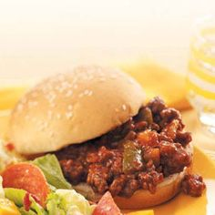 Sloppy Joe Slow Cooker  A recipe for lazy day.. Panda have to bear eating beef and not bamboos :D    2 pounds ground beef  1 cup chopped green pepper  2/3 cup chopped onion  2 cups ketchup  2 envelopes sloppy joe mix  2 tablespoons brown sugar  1 teaspoon prepared mustard  12 hamburger buns, split