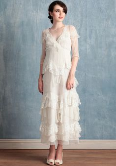 """Viola 399.99 at shopruche.com. Elegant in every detail, this ivory dress in delicate crinkle chiffon cascades with layers of raw edged tulle, lace, and chiffon for wonderfully refined texture. Polished with three-quarter length sheer sleeves, an alluring surplice neckline, and a hidden side zipper closure. Semi-sheer.  Shell: 100% Nylon, Lining: 100% Cotton, Imported, Model is 5'9"""", See size chart below for specific measurements."""
