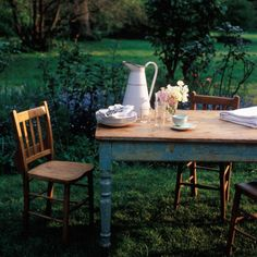 Love the feel of this picture.  Old-school tea party in the back yard :)  Calming and bliss x