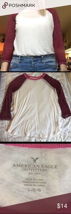 American Eagle baseball tee American Eagle baseball tee. Pretty white and pink/maroon shirt. Thin, perfect for the up coming spring or summer. See through but looks nice with a tank top under. American Eagle Outfitters Tops Tees - Long Sleeve