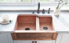 Made from 99% pure, mined copper, this double offset apron sink is the definition of luxury and durability.