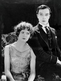 """A still photo of Buster Keaton and Kathryn McGuire on the set of """"The Navigator""""."""
