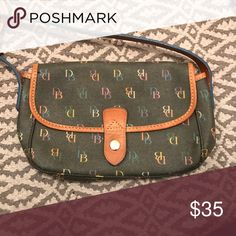 Dooney & Bourke purse The color is a bit faded (reflected in the price) but other than that this bag is in pristine condition. Only used a handful of times. Dooney & Bourke Bags Shoulder Bags