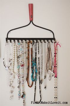 DIY Jewelry Organizer with Old Rake. Use the head of a rake to hung all of your necklaces. You can paint or stain this any color to match your decor.