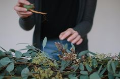 """Fika Gatherings on Instagram: """"This is Bekah, one of our stylists, putting together a center piece from last weeks shoot. It had a base of eucalyptus, with accents of succulents hidden here and there. Sweet and simple, just how we like it! 