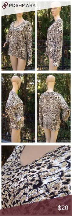 """Chico's Size 3 Sparkly Animal Print Shirt V Neck Excellent condition (handwriting on size tag); Armpit to armpit - 22"""", Shoulder seam to shoulder seam - 17"""", Shoulder seam to end of sleeve - 23"""", Shoulder to bottom hem - 24""""; Rayon, Spandex, Hand wash Chico's Tops Blouses"""