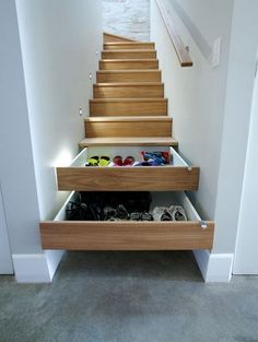 Shoe storage idea > under stairs. Staircase shelves with pull-out drawers holds lots of shoes. Great space saver!