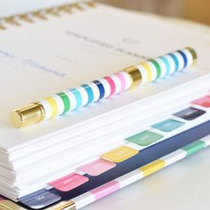 Emily Ley   Simplified Planner Happy Stripes pen with blue Pentel Energel .5 refill