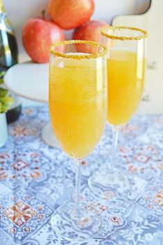 Our Apple Cider Mimosa recipe is truly one of the most delicious fall cocktails. Made with apple cider and champagne, it's ideal to make by the pitcher or to make ahead for your holiday mimosa bar. #applecider #mimosa #champagne #cider #applecidermimosa #thanksgiving