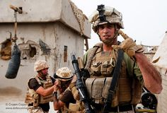 US Marine with Royal Marines at Sangin, Afghanistan by Defence Images, via Flickr