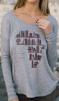 Education is freedom! || The purchase of this cute long sleeve shirt helps provide an education for children in Africa.