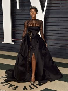 89th OSCARS 2017 Vanity Fair Party  All caught up:Janelle Monáe sported a dress with a fishnet top with a punky waistbelt and...