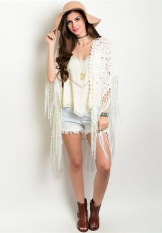 This White Gypsy Lace Kimono features gorgeous lace details all over, along with a fringe trim and shawl style open sides. This piece is perfect for festivals and can be paired with just about any out