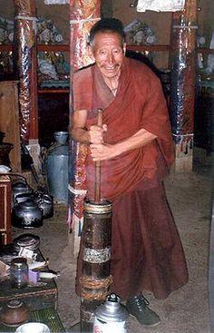 Tibetan Monk churning yak butter tea