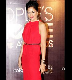 Sameera painting the event red... paired with leopard print cuff.. and the dress is accentuated with a thin black belt... a beauty